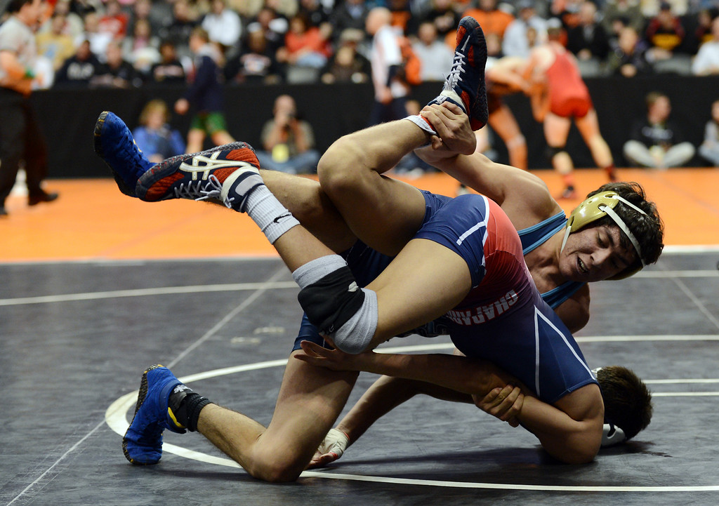 . DENVER, CO. - FEBRUARY 22: Anthony Garza of Horizon High School, top, controls Frank Martinez of Chaparral High School during 106 pound class semifinal of 5A State Championship tournament at Pepsi Center February 22, 2013. Denver, Colorado. Garza won the match. (Photo By Hyoung Chang/The Denver Post)