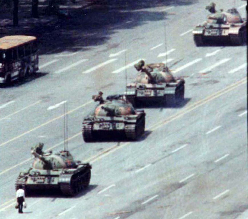 . A Beijing citizen stands in front of tanks on the Avenue of Eternal Peace on June 5, 1989  during the crushing of the Tiananmen Square uprising.  REUTERS/Arthur Tsang