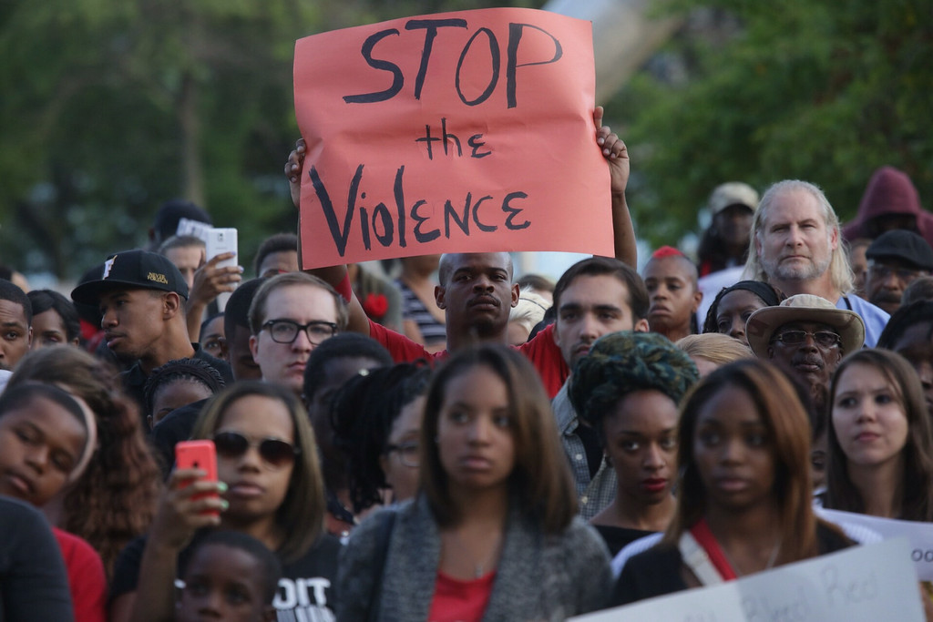 . A large crowd listens during a vigil at Hart Plaza in downtown Detroit on Thursday Aug. 14, 2014. Vigils are being held across the country in the wake of the shooting death of Michael Brown by a police officer in Ferguson, Mo, (AP Photo/Detroit Free Press, Ryan Garza)