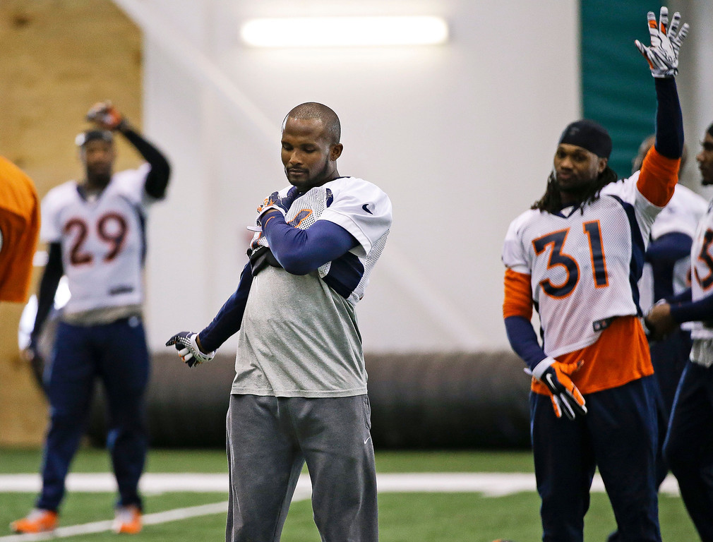 . Denver Broncos cornerback Champ Bailey, center, stretches during practice Thursday, Jan. 30, 2014, in Florham Park, N.J. At left is free safety Michael Huff (29) and at right is safety Omar Bolden (31). The Broncos are scheduled to play the Seattle Seahawks in the NFL Super Bowl XLVIII football game Sunday, Feb. 2, in East Rutherford, N.J. (AP Photo)