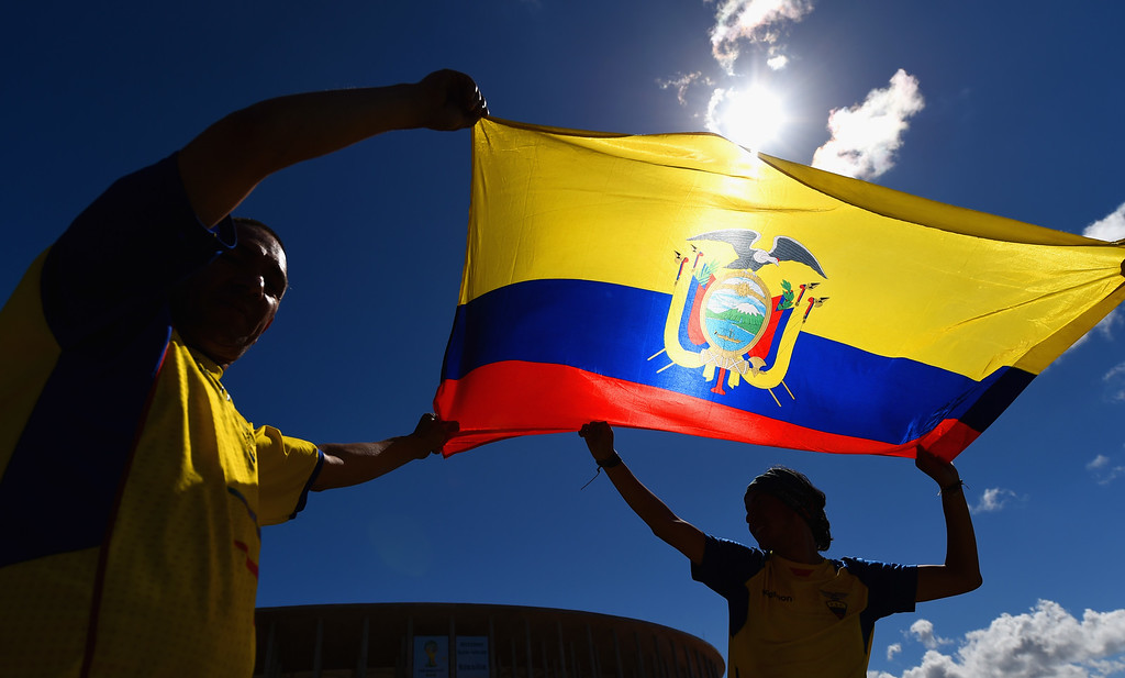 . Ecuador fans wave their flag outside of the National Stadium, ahead of their opening game of the 2014 FIFA World Cup against Switzerland on sunday, on June 12, 2014 in Brasilia, Brazil.  (Photo by Stu Forster/Getty Images)