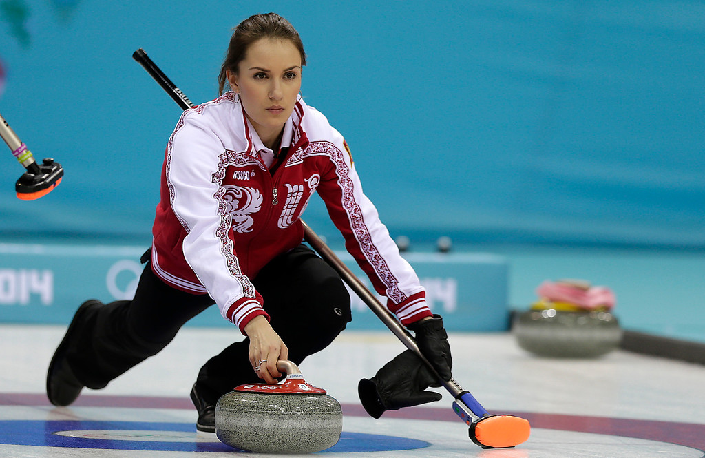 . Russia\'s skip Anna Sidorova delivers the rock during the women\'s curling competition against Denmark at the 2014 Winter Olympics, Monday, Feb. 10, 2014, in Sochi, Russia. (AP Photo/Wong Maye-E)