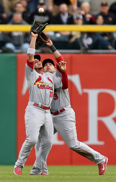 . St. Louis Cardinals\' Jon Jay, with a little nudge from Carlos Beltran, catches a pop fly from Pittsburgh Pirates\' Pedro Alvarez in the fifth inning during Game 4 of the National League Division Series playoffs at PNC Park in Pittsburgh, Pennsylvania, on Monday, October 7, 2013. The Cardinals won, 2-1. (Huy Mach/St. Louis Post-Dispatch/MCT)