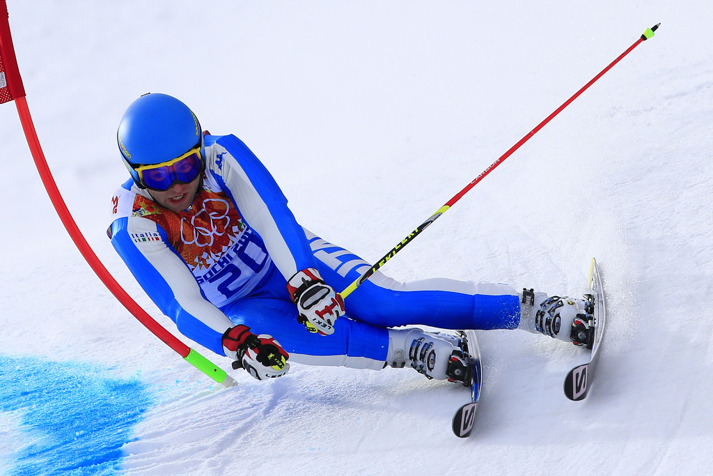 . Italy\'s Davide Simoncelli competes in the Men\'s Alpine Skiing Giant Slalom Run 1 at the Rosa Khutor Alpine Center during the Sochi Winter Olympics on February 19, 2014.  AFP PHOTO / ALEXANDER  KLEIN/AFP/Getty Images