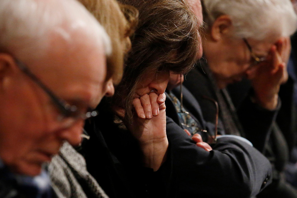 ". Attendees react during a service of remembrance to mark the 25th anniversary of the Lockerbie bombing at Westminster Abbey in London December 21, 2013. Britain, the United States and Libya issued a joint call Saturday for justice over the Lockerbie bombing as services were held to mark the 25th anniversary of the attack, which claimed 270 lives. The three governments gave their ""deepest condolences\"" to relatives of those who died when Pan Am Flight 103 blew up over the Scottish town of Lockerbie on December 21, 1988, en route from London to New York.  AFP PHOTO / POOL / LUKE  MACGREGOR/AFP/Getty Images"