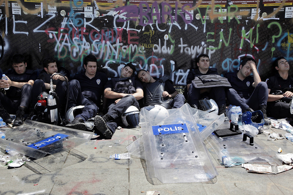 . Turkish riot policemen rest during demonstration on Taksim square, the epicentre of nearly two weeks of anti-government demos, on June 11, 2013 in Istanbul.   AFP PHOTO / GURCAN OZTURK/AFP/Getty Images