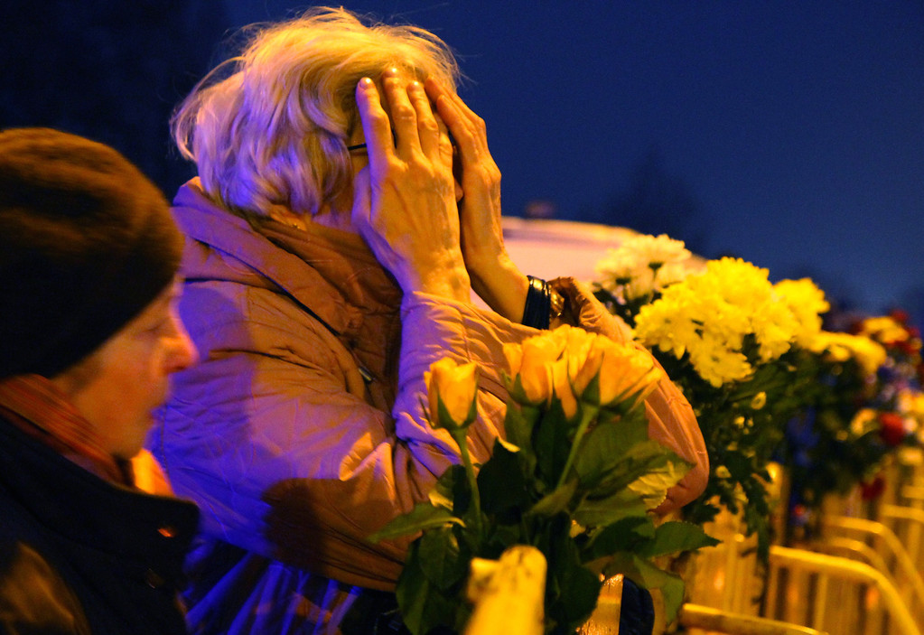 . People leave flowers at the scene where the Maxima supermarket roof collapsed in Riga on November 22, 2013.  AFP PHOTO / PETRAS MALUKAS/AFP/Getty Images