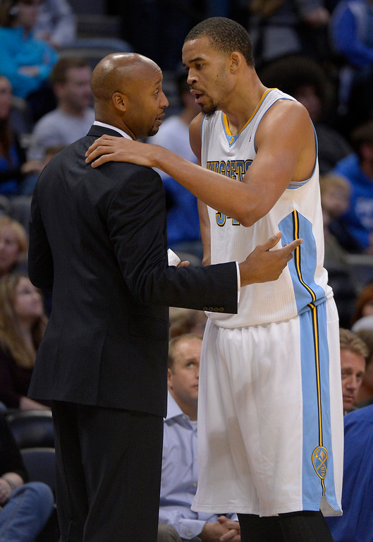 . Denver Nuggets head coach Brian Shaw talks with Denver Nuggets center JaVale McGee (34) as he comes out of the game during the first quarter October 23, 2013 at Pepsi Center. (Photo By John Leyba/The Denver Post)
