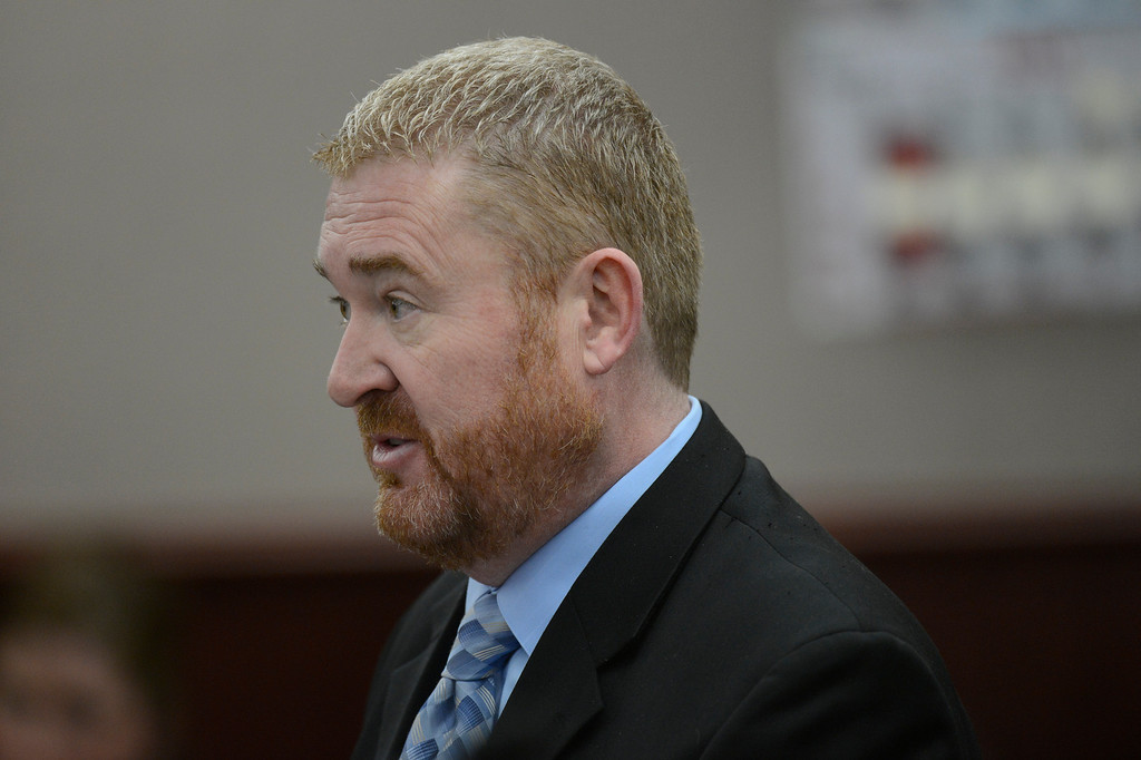 . Defense attorney Daniel King speaks during the proceedings where District Court Judge William Sylvester entered a Not Guilty plea on behalf of Holmes. The trial is set to begin August 5, 2013. (Photo By RJ Sangosti/The Denver Post)