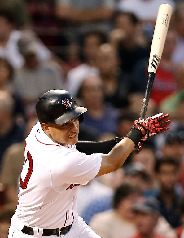 . Boston Red Sox\'s Jose Iglesias watches his single during the third inning of a baseball game against the Colorado Rockies at Fenway Park in Boston on Tuesday, June 25, 2013. (AP Photo/Winslow Townson)