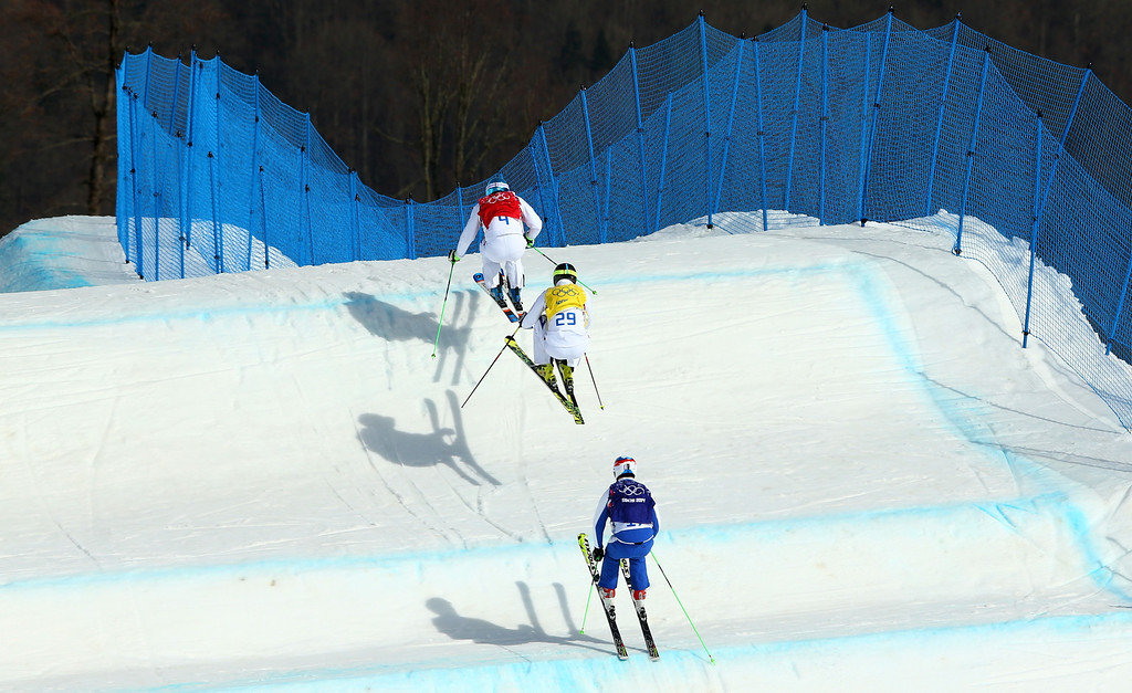 . (Top - Bottom) Jean Frederic Chapuis of France (red bib), Jonathan Midol of France (yellow bib) and Egor Korotkov of Russia (blue bib) compete during the Freestyle Skiing Men\'s Ski Cross 1/2 Finals on day 13 of the 2014 Sochi Winter Olympic at Rosa Khutor Extreme Park on February 20, 2014 in Sochi, Russia.  (Photo by Cameron Spencer/Getty Images)