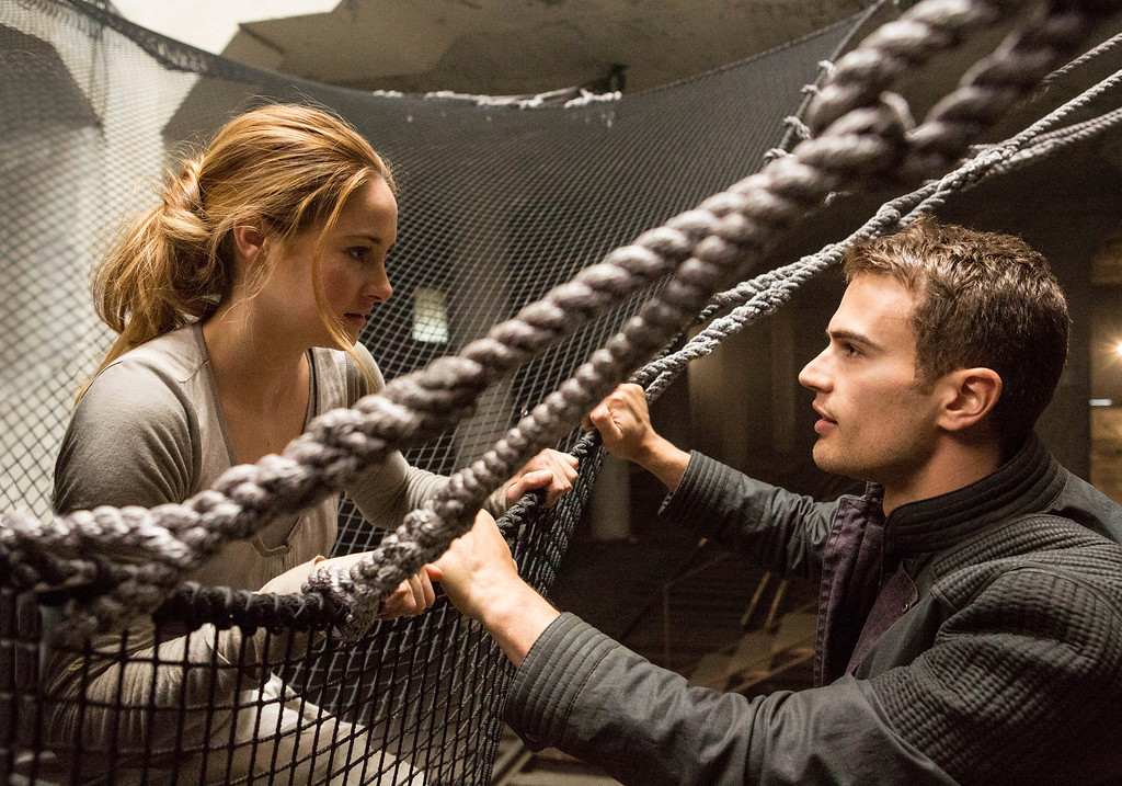 ". This image released by Summit Entertainment shows Shailene Woodley, left, and Theo James in a scene from ""Divergent.\"" (AP Photo/Summit Entertainment, Jaap Buitendijk)"