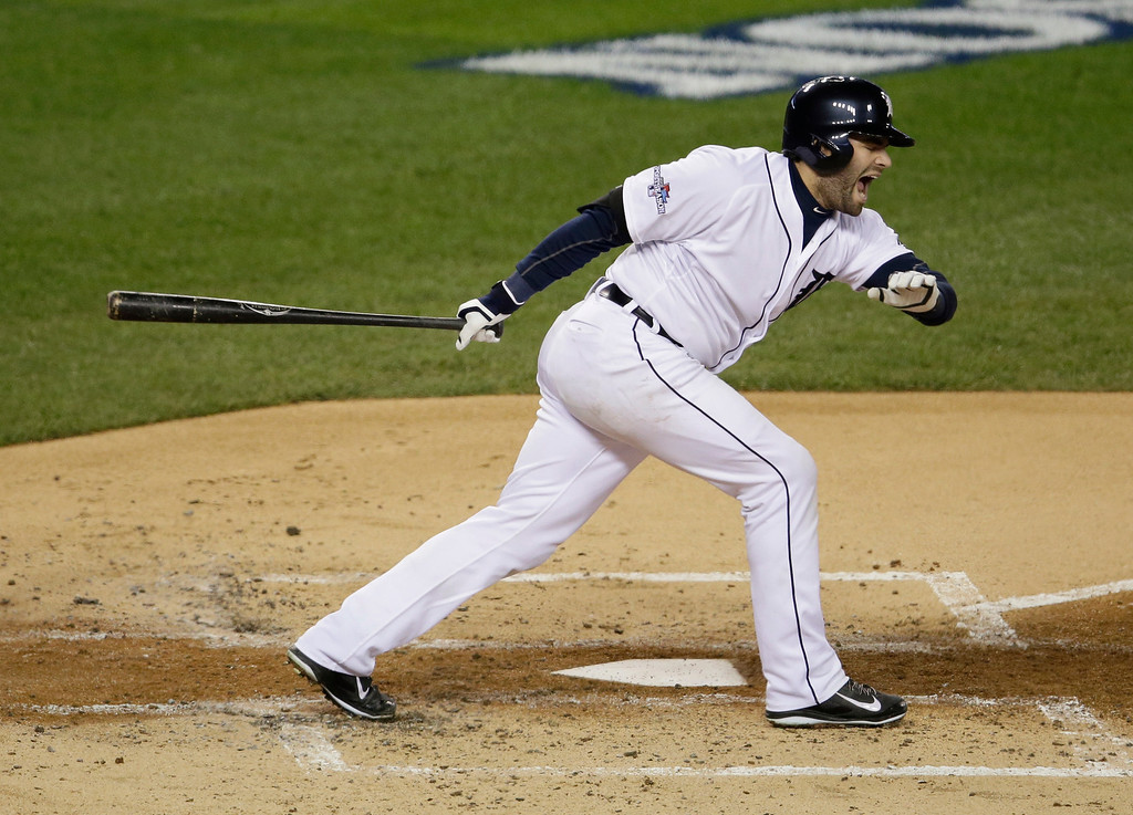 . Detroit Tigers\' Alex Avila reacts after fouling a ball off his foot in the second inning during Game 4 of the American League baseball championship series against the Boston Red Sox, Wednesday, Oct. 16, 2013, in Detroit. (AP Photo/Carlos Osorio)