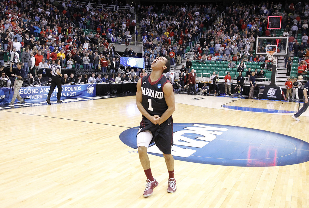 . Harvard\'s Siyani Chambers (1) celebrates after defeating New Mexico 68-62 during a second-round game in the NCAA college basketball tournament in Salt Lake City Thursday, March 21, 2013. (AP Photo/Rick Bowmer)