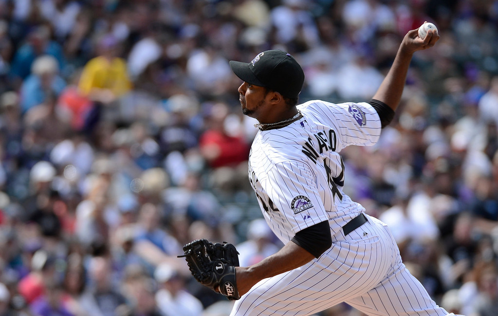 . DENVER, CO. - APRIL 21: Juan Nicasio (44) of the Colorado Rockies delivers a pitch in the first inning against the Arizona Diamondbacks April 21, 2013 at Coors Field. (Photo By John Leyba/The Denver Post)