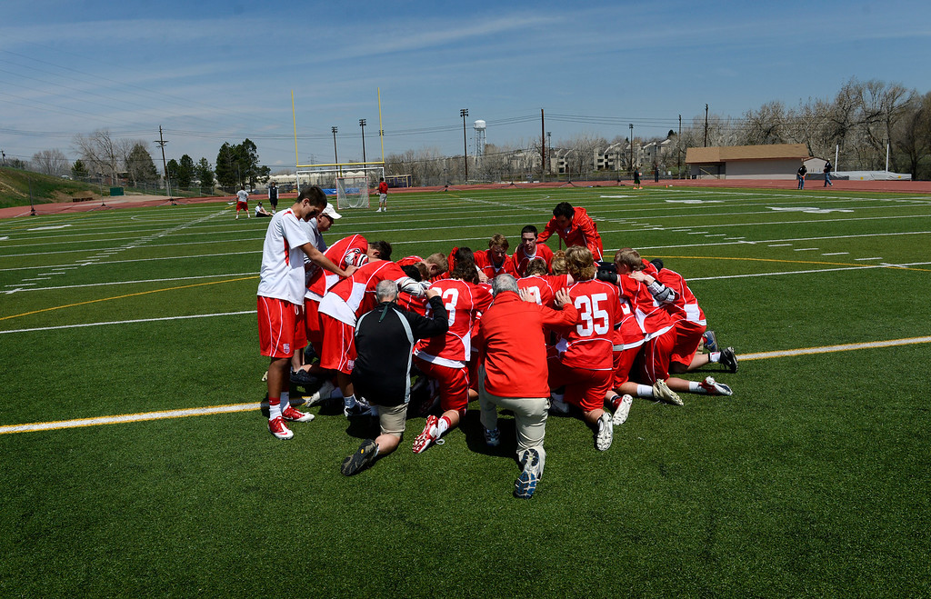 . LITTLETON, CO. - MAY 04:  Regis Jesuit players gather at midfield following the varsity high school lacrosse game between the Arapahoe Warriors and the Regis Jesuit Raiders in Littleton, CO May 04, 2013. The Raiders won the game 9-6.  (Photo By Craig F. Walker/The Denver Post)