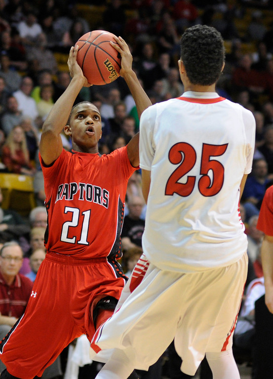 . BOULDER, CO. - MARCH 16: Raptors junior guard Jaisean Jackson (21) worked against Angels guard Ronnie Harrell (25) in the second half. The Denver East High School boy\'s basketball team met Eaglecrest in the 5A championship game Saturday, March 16, 2013 at the Coors Events Center in Boulder.  (Photo By Karl Gehring/The Denver Post)