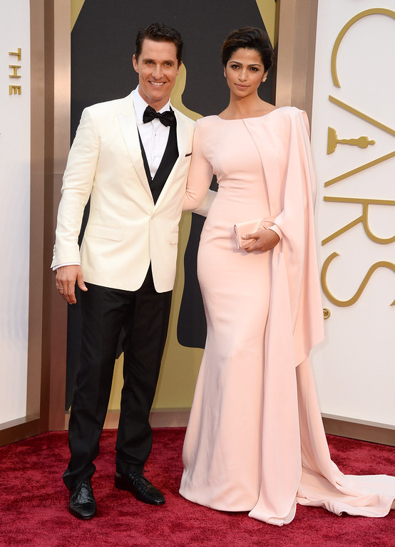 . Matthew McConaughey, left, and Camila Alves arrive at the Oscars on Sunday, March 2, 2014, at the Dolby Theatre in Los Angeles.  (Photo by Jordan Strauss/Invision/AP)