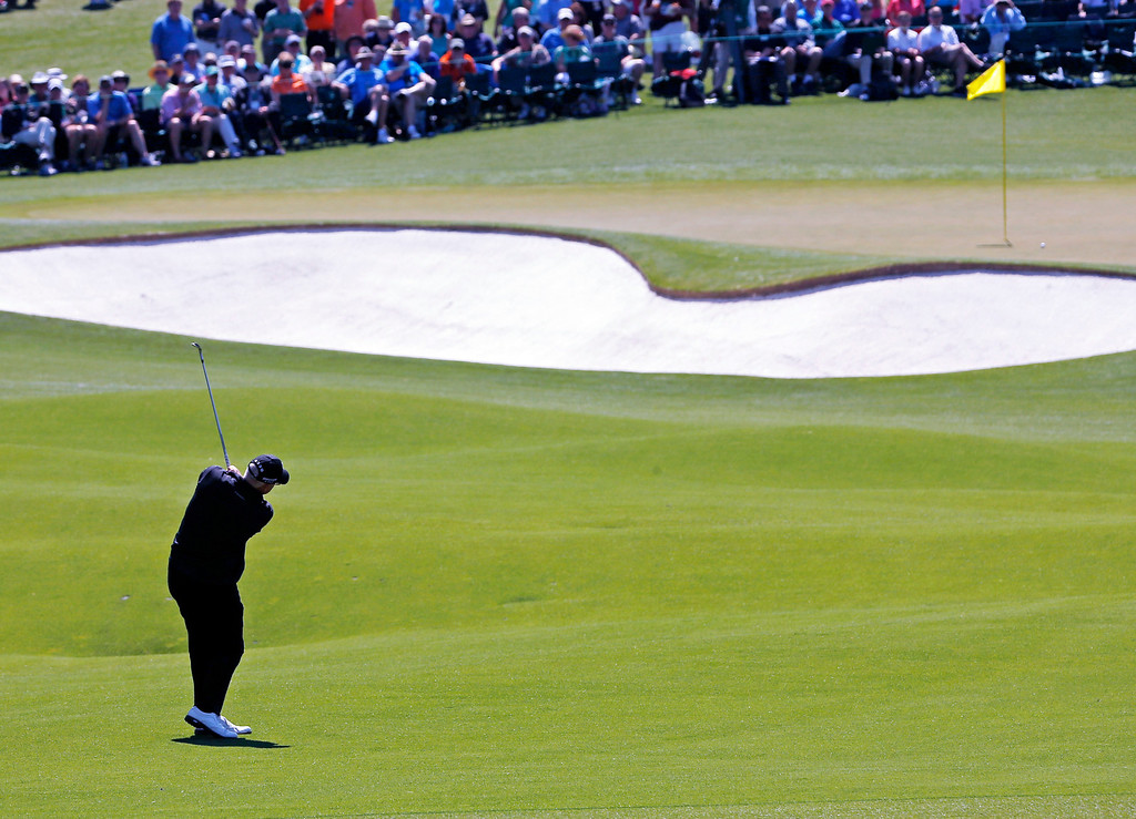 . Sandy Lyle, of Scotland, hits to the second green during the first round of the Masters golf tournament Thursday, April 10, 2014, in Augusta, Ga. (AP Photo/Matt Slocum)
