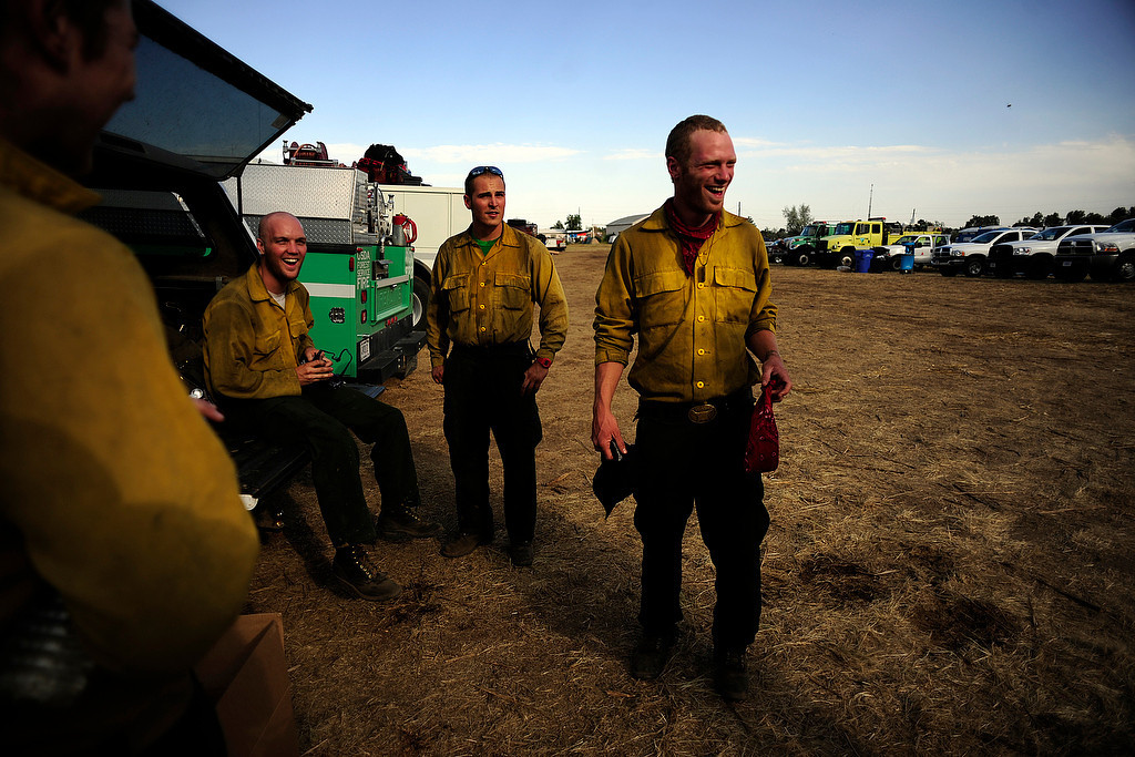 . Todd Clites, of the PatRick fire crew in Boise, jokes with fellow firefighters at the High Park Fire Incident Command Post at the National Guard Armory in Fort Collins on Tuesday, June19, 2012. AAron Ontiveroz, The Denver Post