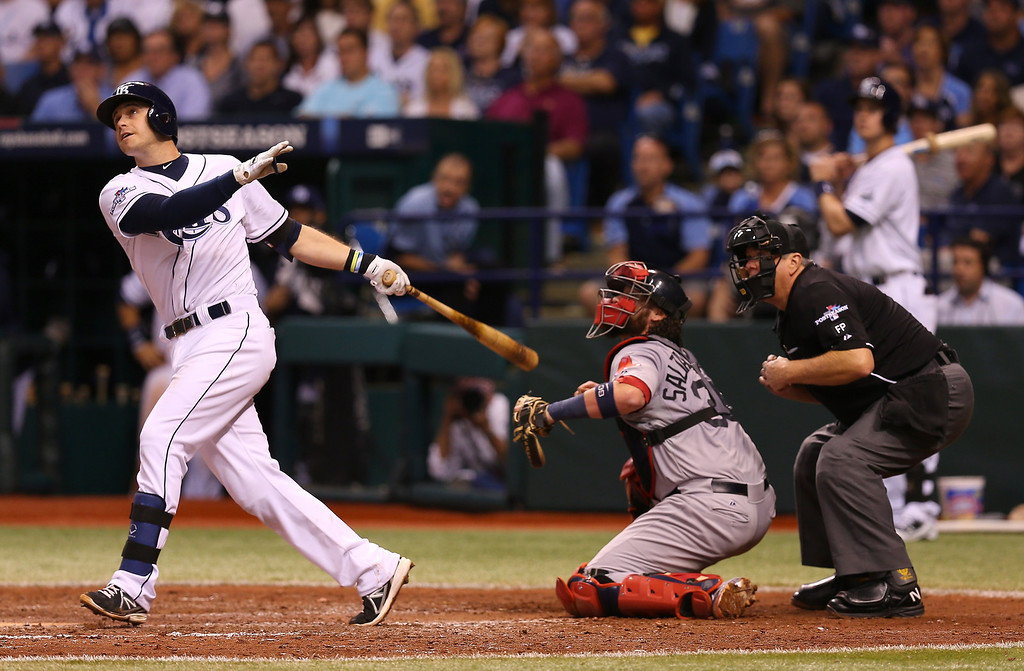 . Evan Longoria #3 of the Tampa Bay Rays hits a three-run home run in the fifth inning against the Boston Red Sox during Game Three of the American League Division Series at Tropicana Field on October 7, 2013 in St Petersburg, Florida.  (Photo by Mike Ehrmann/Getty Images)