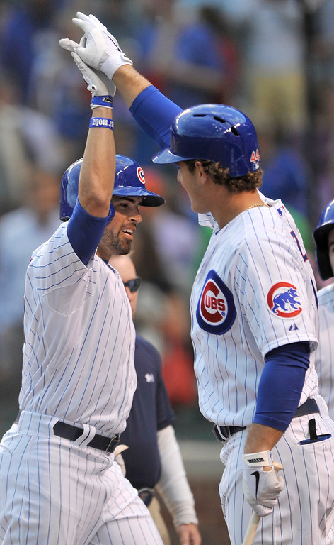 . Chicago Cubs\' David DeJesus, left, celebrates with teammate Anthony Rizzo right, after hitting a solo home run during the first inning of a baseball game against the Colorado Rockies in Chicago, Wednesday, May 15, 2013. (AP Photo/Paul Beaty)