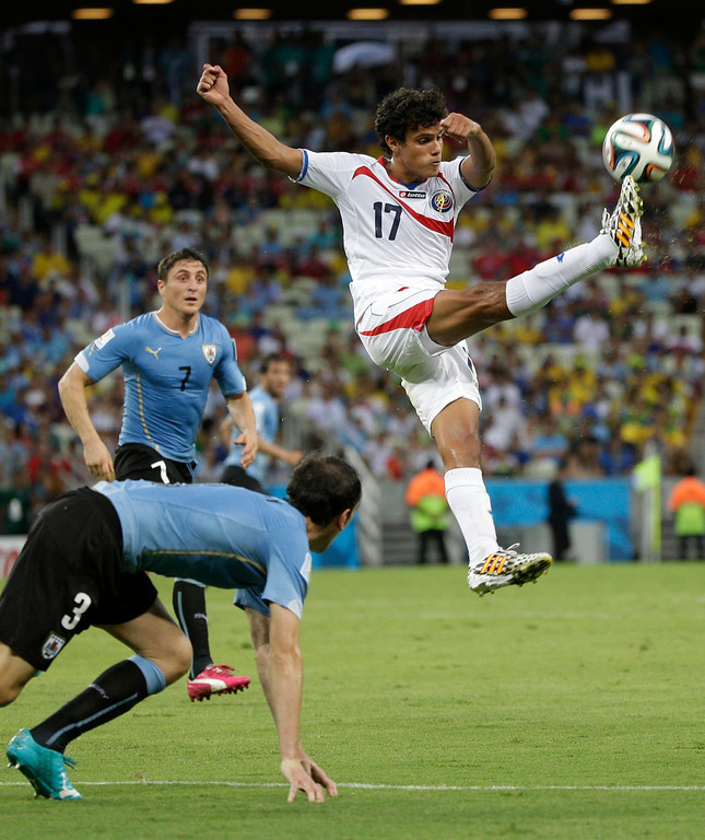 . Costa Rica\'s Yeltsin Tejeda clears the ball during the group D World Cup soccer match between Uruguay and Costa Rica at the Arena Castelao in Fortaleza, Brazil, Saturday, June 14, 2014.(AP Photo/Christophe Ena)