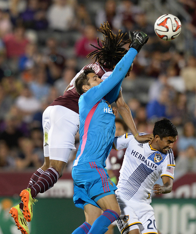 . COMMERCE CITY, CO - MAY 3:  Colorado midfielder Marlon Hairston (94) was shaken up in a collision with Galaxy goalie Jaime Pendedo (18) in the second half. The Colorado Rapids defeated the Los Angeles Galaxy 1-0 Saturday night, May 3, 2014 at Dick\'s Sporting Good Park. (Photo by Karl Gehring/The Denver Post)