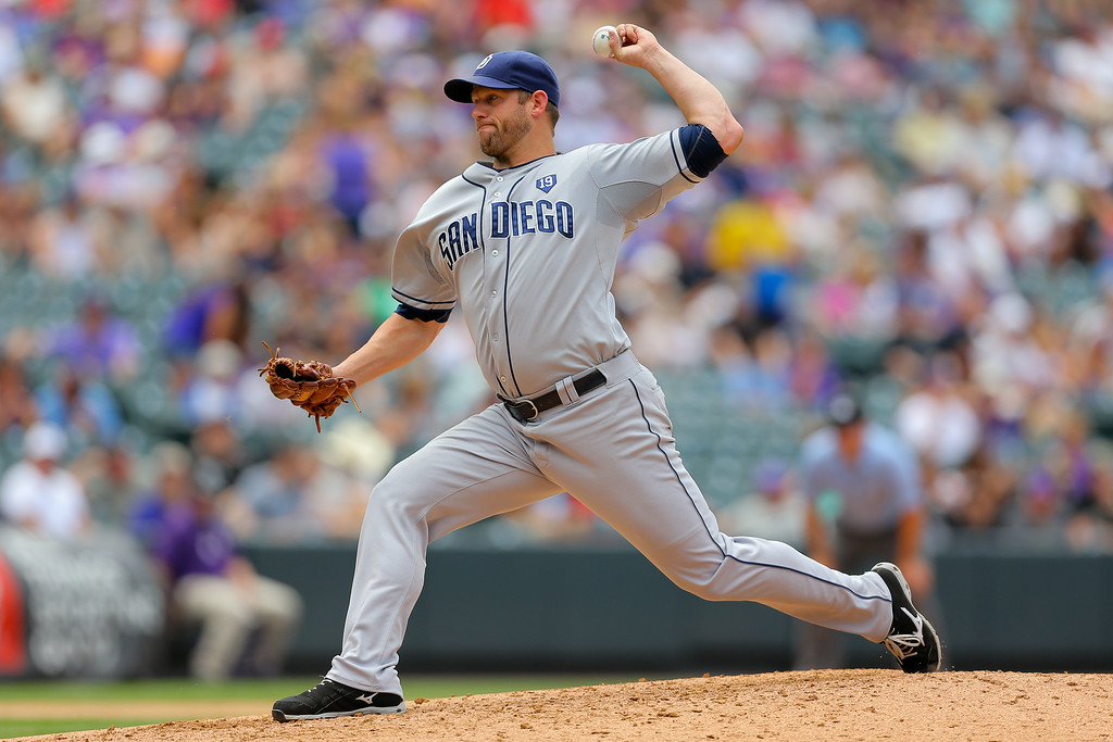 . DENVER, CO - JULY 9:  Starting pitcher Eric Stults #53 of the San Diego Padres delivers to home plate during the fourth inning against the Colorado Rockies at Coors Field on July 9, 2014 in Denver, Colorado. (Photo by Justin Edmonds/Getty Images)