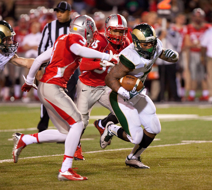 . Colorado State running back Kapri Bibbs outruns the New Mexico defense in the second half of an NCAA college football game Saturday, Nov. 16, 2013, in Albuquerque, N.M. Bibbs rushed for six touchdowns and ran 291 yards during Colorado State\'s 66-42 win. (AP Photo/Eric Draper)