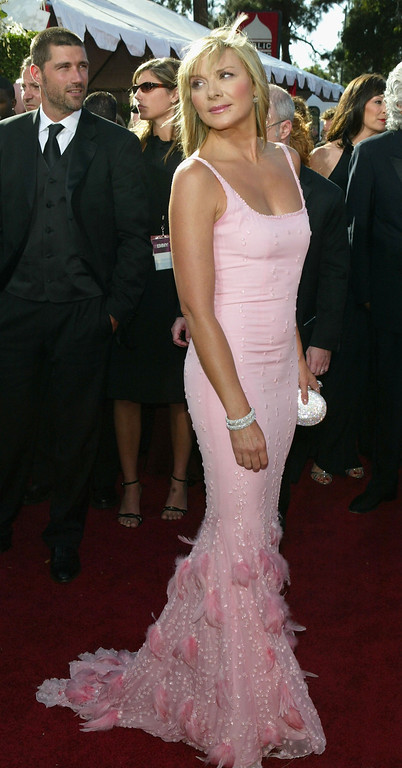 ". Kim Cattrall nominated for Outstanding Supporting Actress in a Comedy Series for ""Sex and the City\"" attends the 56th Annual Primetime Emmy Awards at the Shrine Auditorium September 19, 2004 in Los Angeles, California. (Photo by Kevin Winter/Getty Images)"