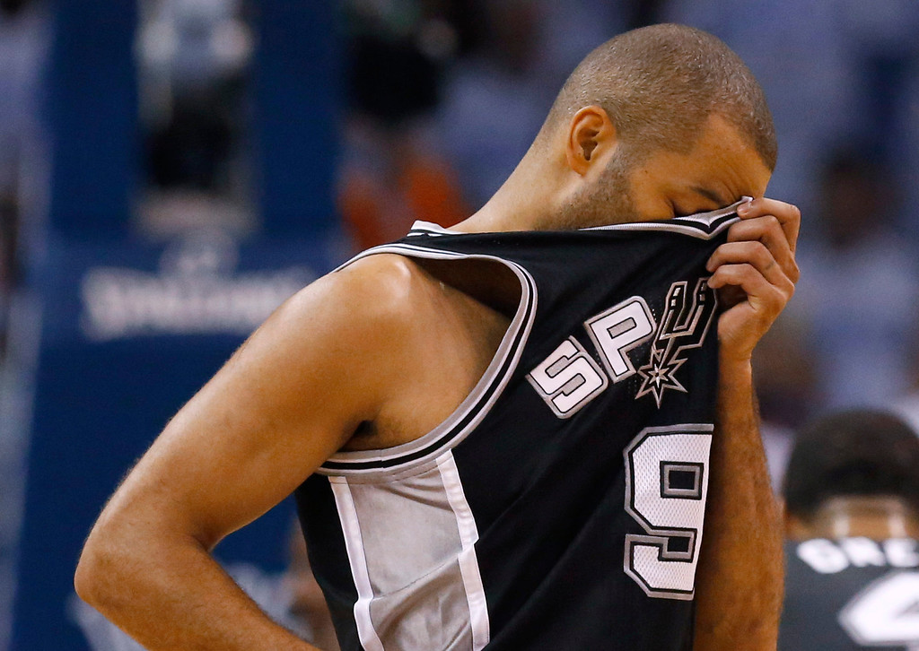 . San Antonio Spurs guard Tony Parker wipes his brow between plays against the Oklahoma City Thunder in the first half of Game 6 of the Western Conference finals NBA basketball playoff series, in Oklahoma City, Saturday, May 31, 2014. (AP Photo/Sue Ogrocki)