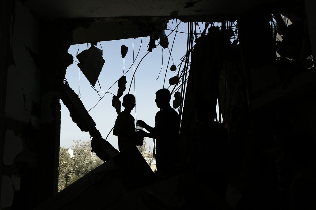 . Palestinians, who were displaced from their houses due to fighting between Israel\'s army and Hamas fighters, return to inspect the condition of their homes in Jabalia in the northern Gaza Strip on August 1, 2014. A 72-hour ceasefire took effect today in Gaza but was immediately threatened by fierce clashes and deadly shelling, as diplomats pressed for a durable end to the 25-day conflict. AFP PHOTO/ MOHAMMED ABED/AFP/Getty Images