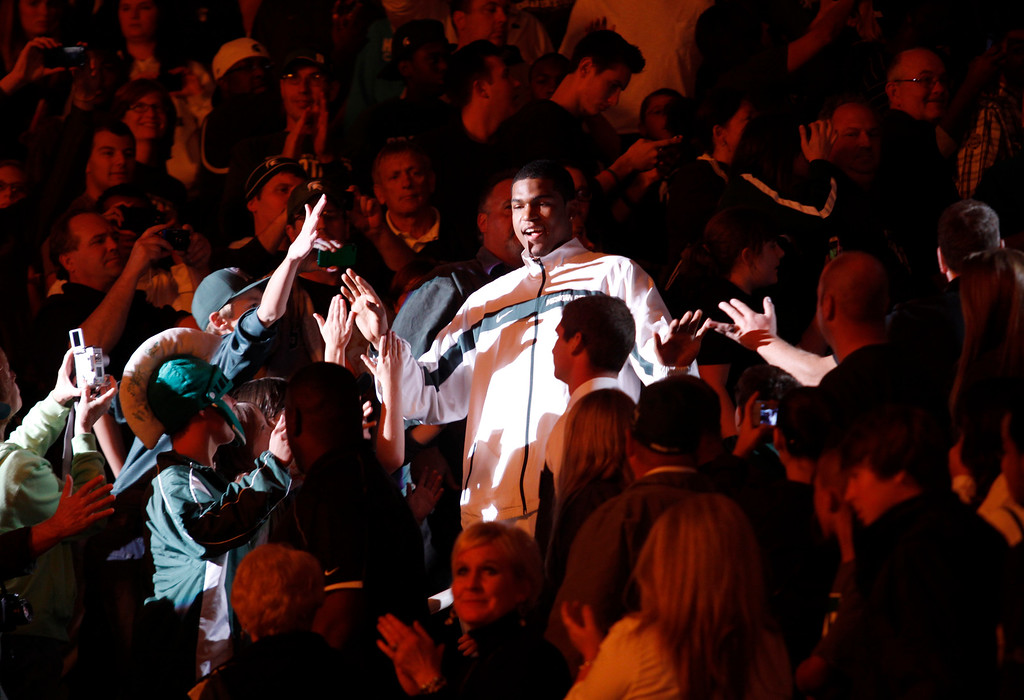 . Michigan State freshman Alvin Ellis III greets fans as he is introduced before an NCAA college basketball scrimmage, Friday, Oct. 18, 2013, in East Lansing, Mich. (AP Photo/Al Goldis)