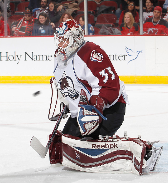 . Goalie Jean-Sebastien Giguere #35 of the Colorado Avalanche stops a shot during the second period of an NHL hockey game against the New Jersey Devils at Prudential Center on February 3, 2014 in Newark, New Jersey.  (Photo by Paul Bereswill/Getty Images)