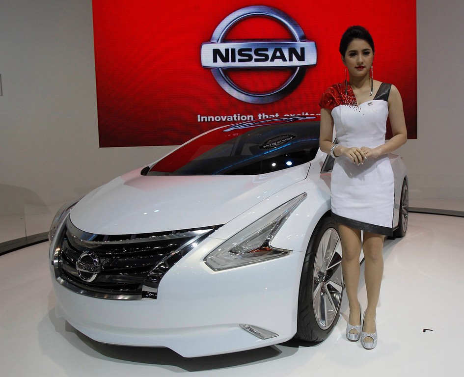 . A model poses beside a Nissan Ellure concept car during a media presentation of the 34th Bangkok International Motor Show in Bangkok March 26, 2013. The Bangkok International Motor Show will be held from March 27 to April 7. REUTERS/Chaiwat Subprasom