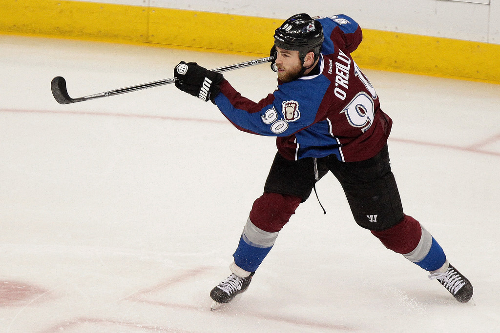 . Colorado Avalanche\'s Ryan O\'Reilly follows through on a goal against Minnesota Wild goalie Darcy Kuemper during the first period of an NHL hockey game Thursday, Jan. 30, 2014, in Denver. (AP Photo/Barry Gutierrez)