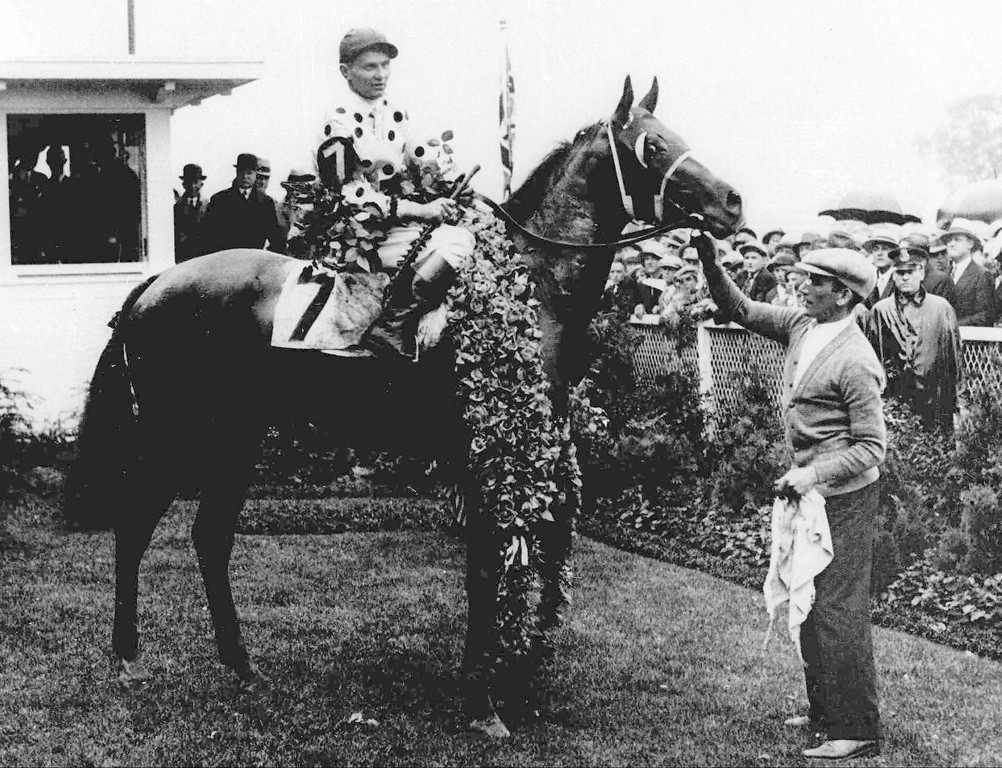 . 1930: GALLANT FOX - Gallant Fox, with jockey Earl Sande up, wears the roses after winning the 1930 Kentucky Derby. Gallant Fox went on to win the Triple Crown. (AP Photo)