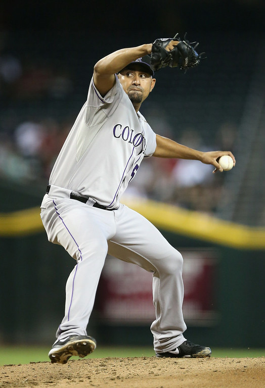 . Starting pitcher Franklin Morales #56 of the Colorado Rockies pitches against the Arizona Diamondbacks during the MLB game at Chase Field on August 10, 2014 in Phoenix, Arizona.  (Photo by Christian Petersen/Getty Images)