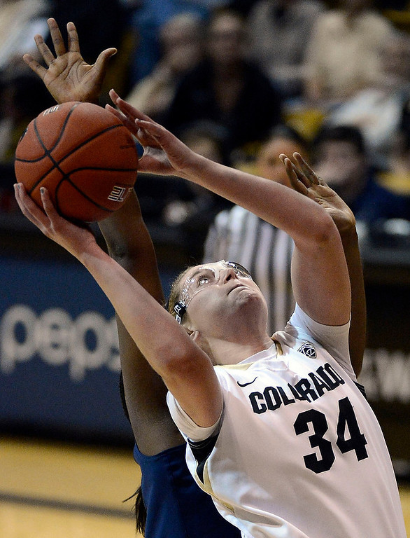 . Colorado Buffaloes forward Jen Reese (34) goes up for a shot on California Golden Bears center Talia Caldwell (33) during the second half Sunday, January 6, 2013 at Coors Events Center. John Leyba, The Denver Post