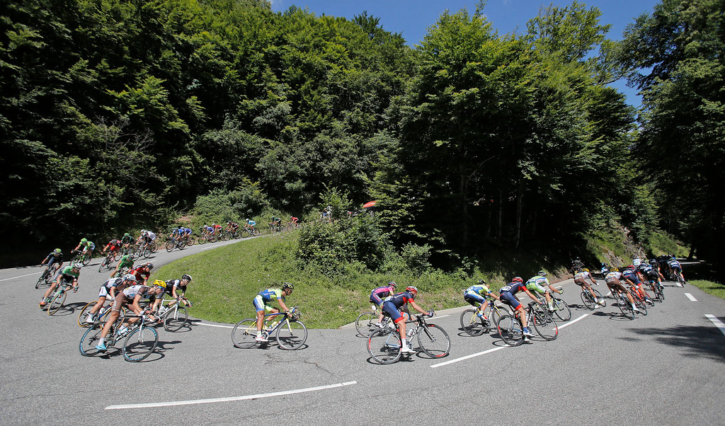 . The pack speeds down Portillon pass during the seventeenth stage of the Tour de France cycling race over 124.5 kilometers (77.4 miles) with start in Saint-Gaudens and finish in Saint-Lary, France, Wednesday, July 23, 2014. (AP Photo/Christophe Ena)
