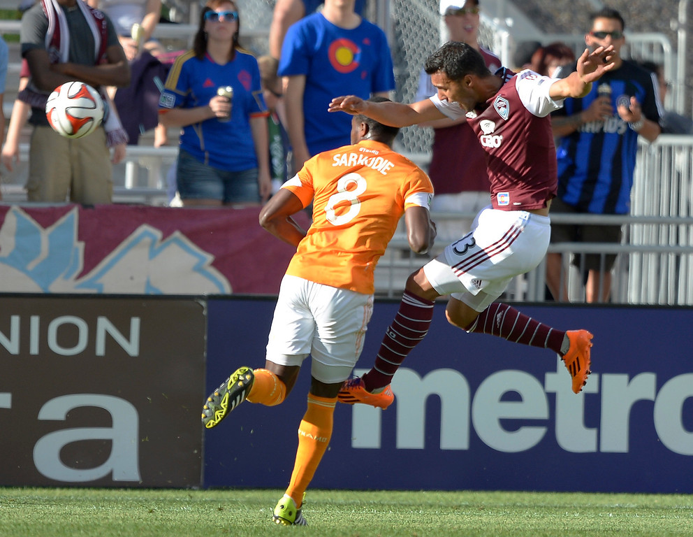 . Colorado Rapids forward Kamani Hill (13) heads the ball past Houston Dynamo defender Kofi Sarkodie (8) during the first half June 1, 2014 at Dick\'s Sporting Goods Park. (Photo by John Leyba/The Denver Post)