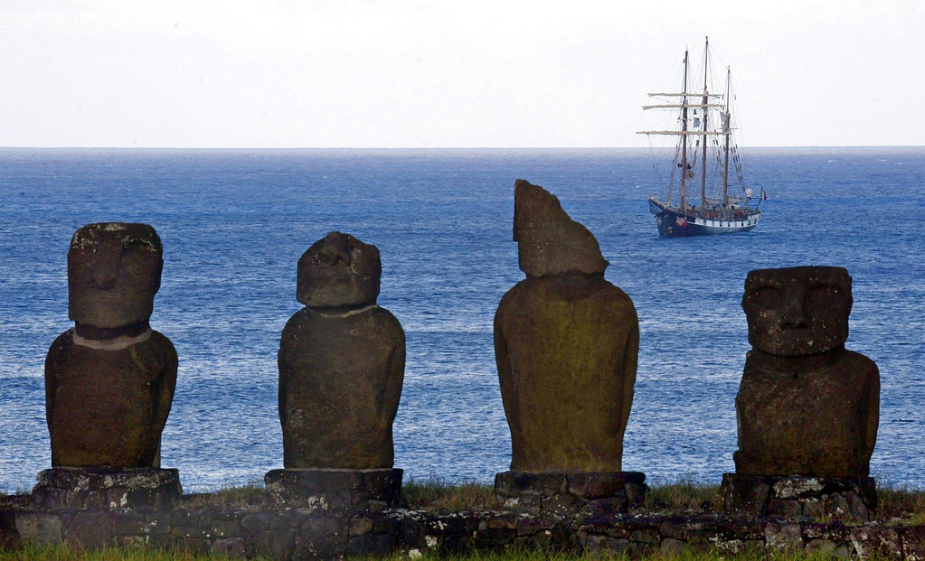 . Monoliths are seen in the foreground, as La Boudeuse, the three-masted schooner captained by French explorer Patrice Franseschi is anchored in Hanga Roa Otai cove in Easter Island, Chile, 3 February, 2005. MARTIN BERNETTI/AFP/Getty Images