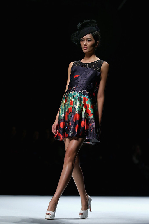 . A model showcases designs by Chinese designer Yuan Bing on the runway at VISCAP Yuan Bing Collection show during Mercedes-Benz China Fashion Week Spring/Summer 2014 at Beijing Hotel on October 28, 2013 in Beijing, China.  (Photo by Feng Li/Getty Images)