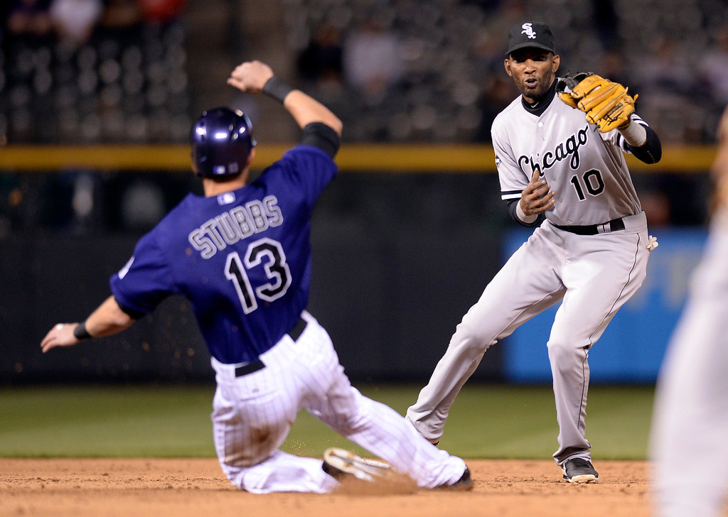 . Chicago shortstop Alexei Ramirez made a force out of Colorado baserunner Drew Stubbs at second base in the eighth inning.   (Photo by Karl Gehring/The Denver Post)