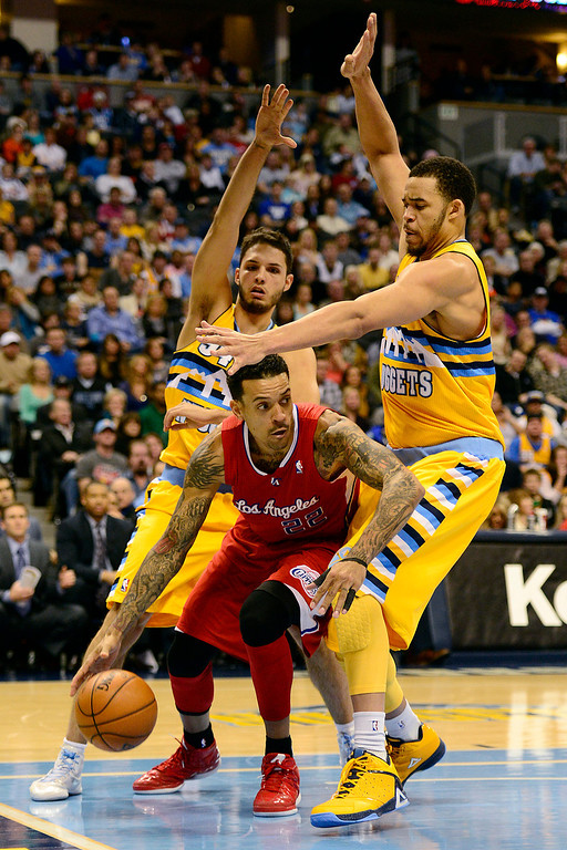 . Denver Nuggets center JaVale McGee (34) and shooting guard Evan Fournier (94) pressure Los Angeles Clippers small forward Matt Barnes (22) during the second half of the Nugget\'s 92-78 win at the Pepsi Center on Tuesday, January 1, 2013. AAron Ontiveroz, The Denver Post