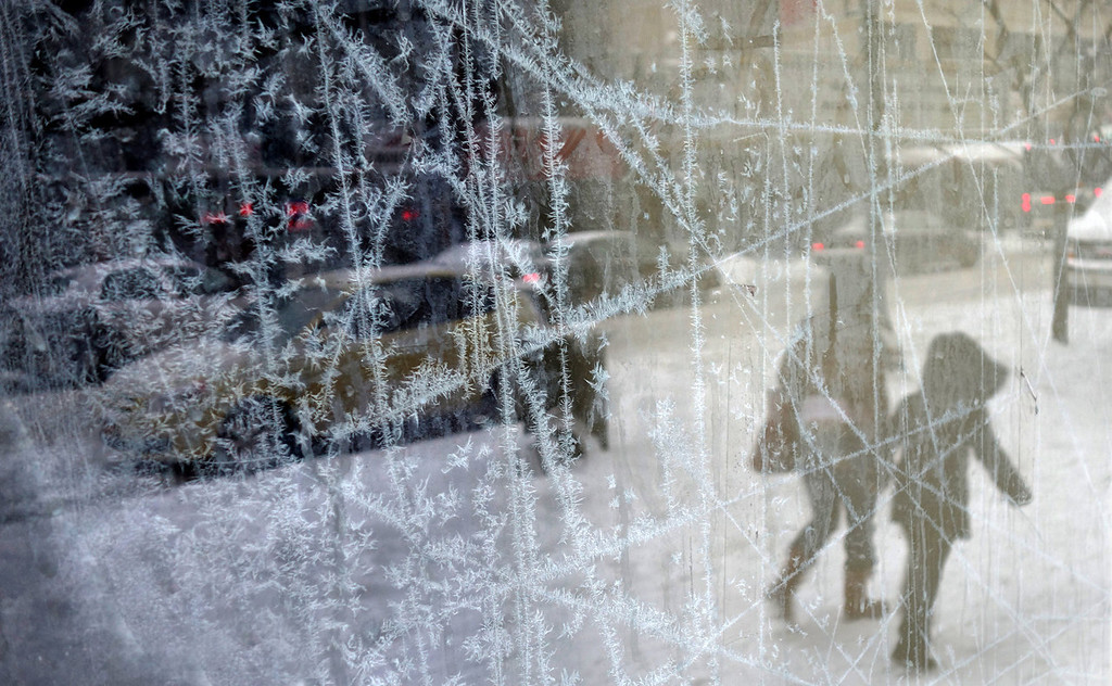 . Ice crystals form on an abandoned store\'s front window in Syracuse, N.Y., Thursday, Jan. 2, 2014. New York City public schools were closed Friday after up to 7 inches of snow fell by morning in the first snowstorm of the winter. (AP Photo/The Syracuse Newspapers, Mike Greenlar)