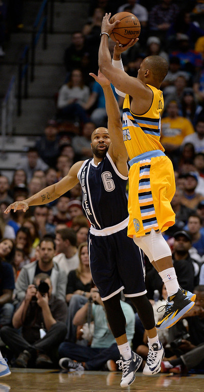 . Denver Nuggets shooting guard Randy Foye (4) takes a shot over Oklahoma City Thunder point guard Derek Fisher (6) during the fourth quarter January 9, 2014 at Pepsi Center. Foye led all Nuggets players with 24 point on the night. (Photo by John Leyba/The Denver Post)