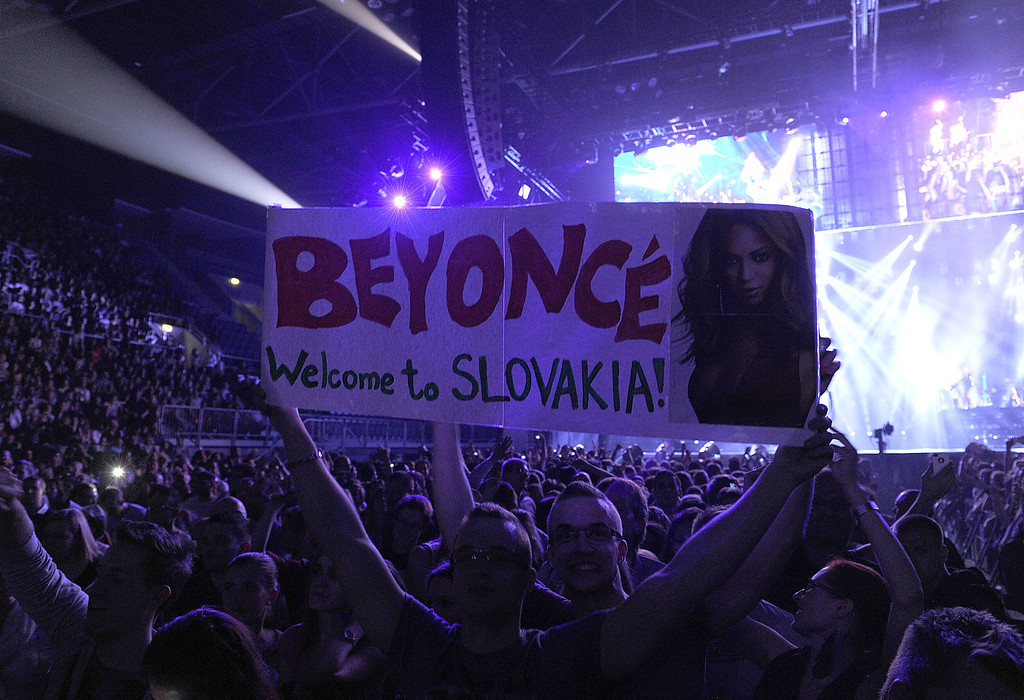 """. Fans attend the Beyonce \""""Mrs. Carter Show World Tour 2013\"""", on Friday, April 19, 2013 at the Slovnaft Arena in Bratislava, Slovakia. (Photo by Frank Micelotta/Invision for Parkwood Entertainment/AP Images)"""