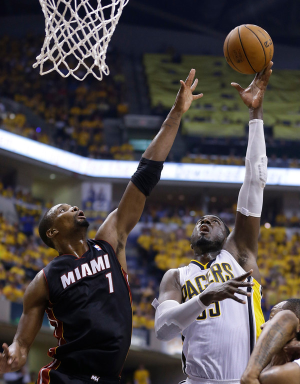 . Indiana Pacers center Roy Hibbert (55) shoots over Miami Heat center Chris Bosh during the second half of Game 5 of the NBA basketball Eastern Conference finals in Indianapolis, Wednesday, May 28, 2014. (AP Photo/Michael Conroy)